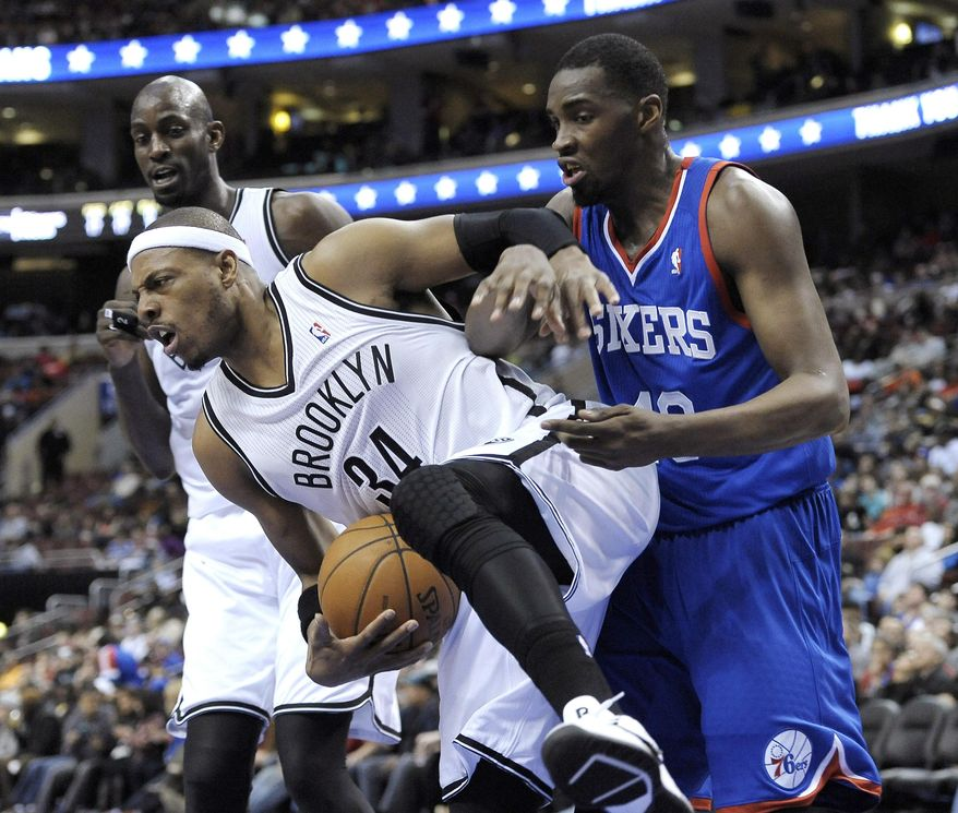 Brooklyn Nets' Paul Pierce (34) steals the ball from  Philadelphia 76ers' Jarvis Varnado from during the first half of an NBA basketball game on Saturday, April 5, 2014, in Philadelphia. (AP Photo/Michael Perez)
