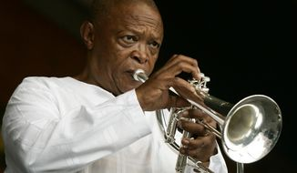 FILE - In an April 29, 2006 file photo, Hugh Masekela performs during the 2006 New Orleans Jazz and Heritage Festival in New Orleans.  (AP Photo/Jeff Christensen, File)