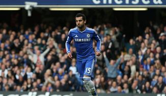 Chelsea's Mohamed Salah turns as he celebrates after scoring the opening goal of the English Premier League soccer match between Chelsea and Stoke City at Stamford Bridge stadium in London, Saturday, April, 5, 2014. (AP Photo/Alastair Grant)