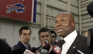 Buffalo Bills hall of fame defensive end Bruce Smith answers questions from the media during a public memorial and remembrance being held inside the NFL football team's fieldhouse for Buffalo Bills owner Ralph C. Wilson in Orchard Park, N.Y., Saturday, April 5, 2014. Wilson, the team's founder and sole owner, died March 25. (AP Photo/Nick LoVerde)