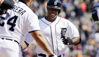 Detroit Tigers' Torii Hunter is congratulated by teammate Miguel Cabrera after a two-run home run during the fifth inning of a baseball game against the Baltimore Orioles in Detroit, Saturday, April 5, 2014. (AP Photo/Carlos Osorio)