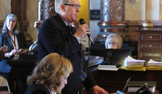 Republican party Kansas state Sen. Clark Shultz, of McPherson, Kan. explains a bill making technical changes in Kansas anti-abortion laws during the Senate's session at the Statehouse in Topeka, Kan. on Saturday, April 5, 2014. Lawmakers passed the bill and avoided a debate over more controversial abortion proposals. (AP Photo/John Hanna)