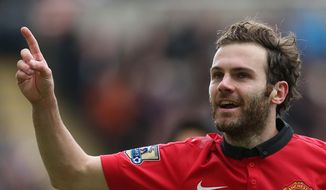 Manchester United's Juan Mata celebrates his goal during their English Premier League soccer match against Newcastle United at St James' Park, Newcastle, England, Saturday, April 5, 2014. (AP Photo/Scott Heppell)