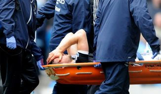 Southampton's Jay Rodriguez  is taken off the pitch after being injured during the English Premier League soccer match between Manchester City and Southampton at The Etihad Stadium, Manchester, England, Saturday, April  5, 2014.  (AP Photo/Rui Vieira)
