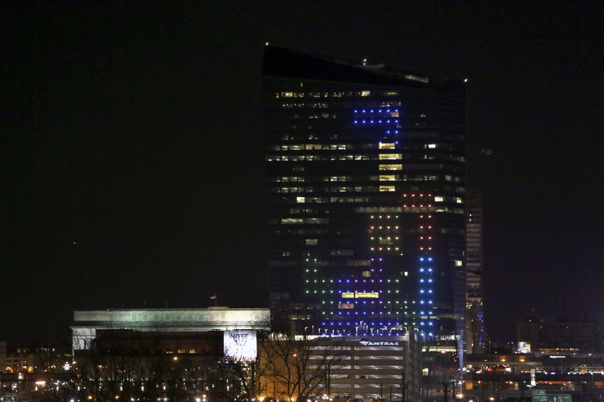 The classic video game Tetris is played on the 29-story Cira Centre in Philadelphia, Saturday, April 5, 2014, using hundreds of LED lights embedded in its glass facade. The spectacle kicks off a citywide series of events called Philly Tech Week and also celebrates the upcoming 30th anniversary of Tetris. (AP Photo/ Joseph Kaczmarek)