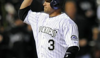Colorado Rockies Michael Cuddyer celebrates a two-run home run in the fourth inning of a baseball game against the Arizona Diamondbacks on Saturday, April 5, 2014, in Denver. (AP Photo/Chris Schneider)