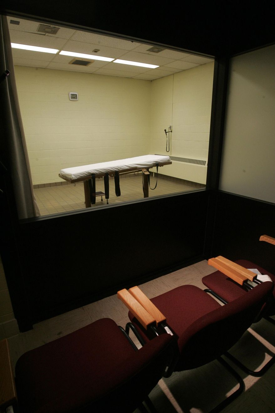 FILE - In this Nov. 2005, file photo is the witness room that adjoins the death chamber at the Southern Ohio Correctional Facility in Lucasville, Ohio. An Associated Press survey of the nation's 32 death penalty states found that the vast majority refuse to disclose the source of their execution drugs. While Ohio has been open about drugs purchased for executions, those cloaked in secrecy include states with some of the most active death chambers _ Texas, Florida, Oklahoma and Missouri among them. (AP Photo/Kiichiro Sato, File)