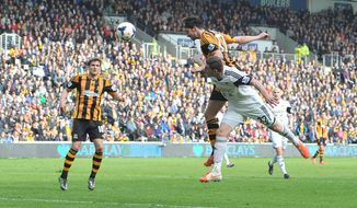 Hull City's George Boyd, top, heads the ball to score his side's first goal during their English Premier League soccer match against Swansea City at the KC Stadium, Hull, England, Saturday, April 5, 2014. (AP Photo/Dave Howarth, PA Wire)  UNITED KINGDOM OUT    -   NO SALES   -   NO ARCHIVES