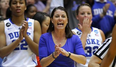 FILE - In this March 22, 2014 photo, Duke coach Joanne P. McCallie urges her team during the first half against Winthrop in a first-round game in the NCAA college basketball tournament in Durham, N.C. (AP Photo/Ted Richardson)