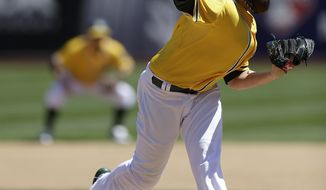 Oakland Athletics' Dan Straily works against the Seattle Mariners in the first inning of a baseball game on Saturday, April 5, 2014, in Oakland, Calif. (AP Photo/Ben Margot)