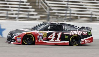 Kurt Busch makes a turn during a practice session for the NASCAR Sprint Cup Series auto race at Texas Motor Speedway in Fort Worth, Texas, Saturday, April 5, 2014. (AP Photo/LM Otero)