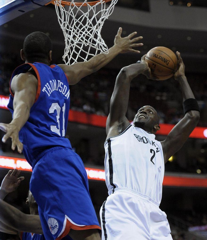 Brooklyn Nets' Kevin Garnett (2) shoots over Philadelphia 76ers' Hollis Thompson during the first half of an NBA basketball game on Saturday, April 5, 2014, in Philadelphia. (AP Photo/Michael Perez)
