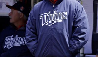 Minnesota Twins manager Ron Gardenhire stands in the dugout in the first inning of a baseball game against the Cleveland Indians, Saturday, April 5, 2014, in Cleveland. (AP Photo/Tony Dejak)