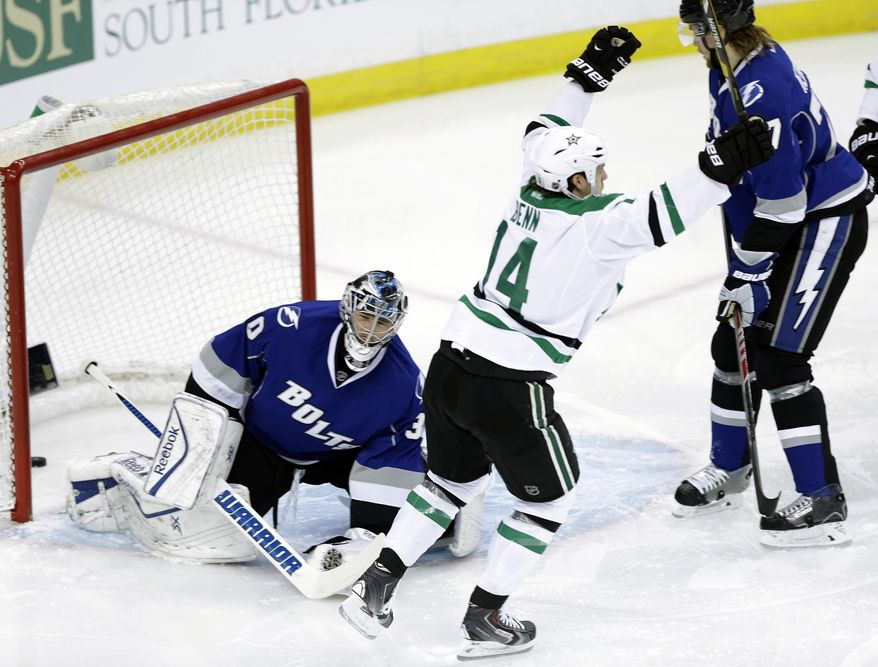 Dallas Stars left wing Jamie Benn (14) celebrates after scoring past Tampa Bay Lightning goalie Ben Bishop (30) during the first period of an NHL hockey game on Saturday, April 5, 2014, in Tampa, Fla. (AP Photo/Chris O'Meara)