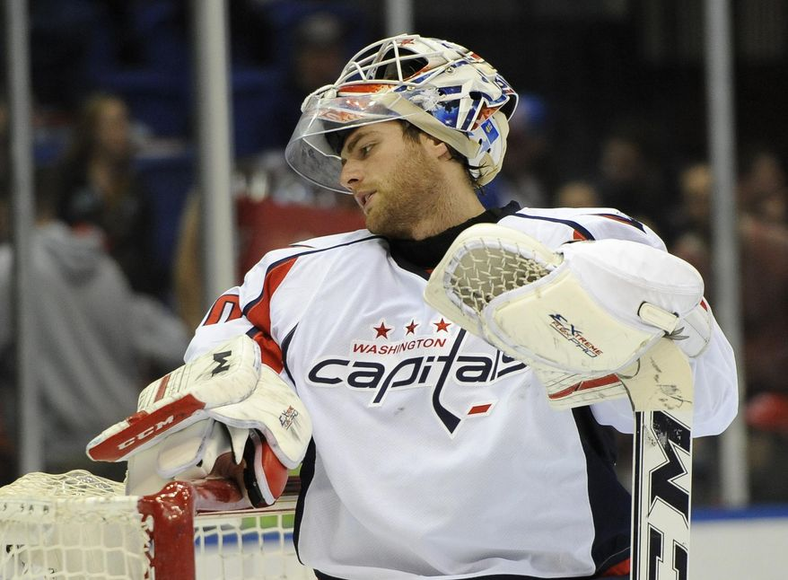 Washington Capitals goalie Braden Holtby (70) reacts after New York Islanders John Persson scored a goal in the second period of an NHL hockey game, Saturday, April 5, 2014, in Uniondale, N.Y. (AP Photo/Kathy Kmonicek)