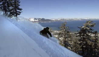 FILE - This Dec. 14, 2003 file photo shows a skier on a run at Heavenly Ski Resort above South Lake Tahoe, Calif. A mountain weather instructor has stressed the importance of learning to read mountain weather before heading into the backcountry to avoid the danger of avalanches. (AP Photo/Dino Vournas)