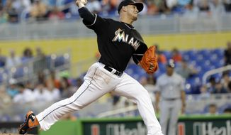 Miami Marlins' Jose Fernandez pitches against the San Diego Padres in the first inning of a baseball game against the San Diego Padres in Miami, Saturday, April 5, 2014. (AP Photo/Alan Diaz)
