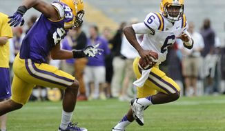 LSU quarterback Brandon Harris (6) turns the corner to get outside past the pursuit of defensive end Michael Patterson (93) at the NCAA college football Spring Game in Baron Rouge, La., Saturday, April 5, 2014. (AP Photo/The Baton Rouge Advocate, Travis Spradling) NO SALES; MAGAZINES OUT; INTERNET OUT; TV OUT; FOREIGN OUT; LOUISIANA BUSINESS INC. OUT (INCLUDING GREATER BATON ROUGE BUSINESS REPORT; 225; 10/12; INREGISTER; LBI CUSTOM OUT; MANDATORY CREDIT THE ADVOCATE