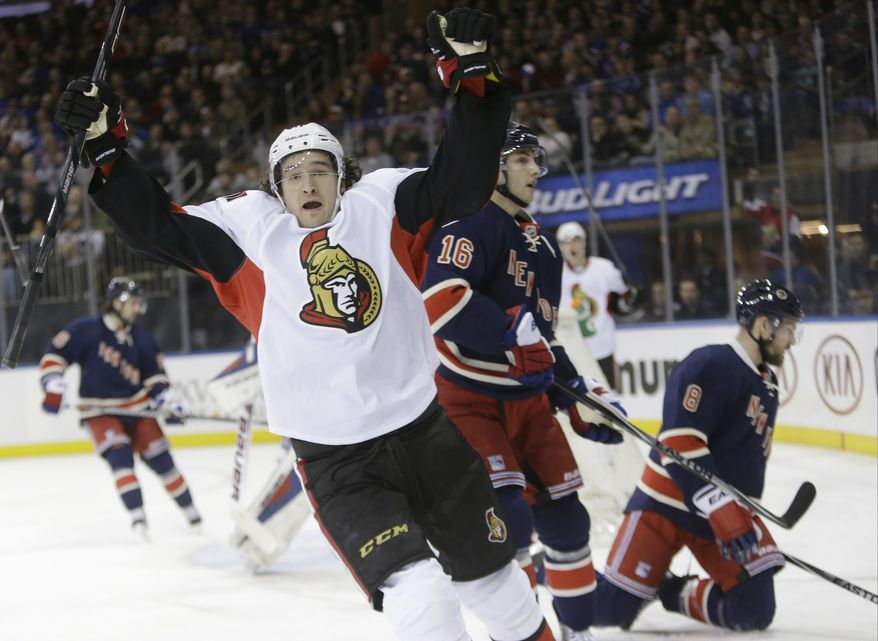Ottawa Senators' Mark Stone, left, celebrates after scoring a goal as New York Rangers' Kevin Klein (8) and Derick Brassard (16) skate past him during the first period of an NHL hockey game, Saturday, April 5, 2014, in New York. (AP Photo/Frank Franklin II)