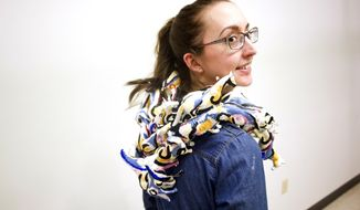 "FOR RELEASE SATURDAY, APRIL 5, 2014, AT 12:01 A.M. CDT. - In this photo taken March 26, 2014, University of Iowa graduate student Christiana Byrne shows off her wearable art piece at the UI Studio Arts Building Iowa City, Iowa. Byrne's piece will join 11 other wearable works inspired by artist Jackson Pollock's ""Mural"" in the Oakdale Ballroom at the Coralville Marriott Hotel & Conference Center on Saturday, April 12. (AP Photo/Iowa City Press-Citizen, Benjamin Roberts) NO SALES."