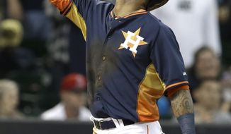 Houston Astros' Jonathan Villar gestures at home plate after hitting a two-run home run against the Los Angeles Angels in the seventh inning of a baseball game on Sunday, April 6, 2014, in Houston. (AP Photo/Pat Sullivan)