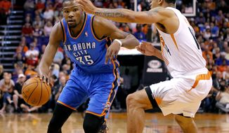 Oklahoma City Thunder forward Kevin Durant (35) drives against Phoenix Suns guard Gerald Green (14) during the first half of an NBA basketball game on Sunday, April 6, 2014,in Phoenix. (AP Photo/Matt York)