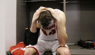 Wisconsin forward Frank Kaminsky reacts in the locker room after his team's 74-73 loss to Kentucky in an NCAA Final Four tournament college basketball semifinal game Saturday, April 5, 2014, in Arlington, Texas. (AP Photo/David J. Phillip)
