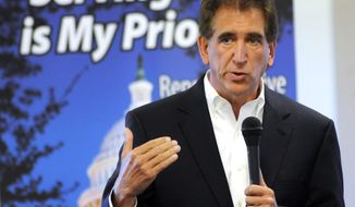 FILE-This Thursday, Aug. 15, 2013 file photo shows Rep. Jim Renacci, R-Ohio, speaking at a town hall meeting at Schmid Hall in Orrville, Ohio. Ohio Democrats who hold a small minority in their congressional delegation are heading into the primary elections with basically nothing to lose and hoping to gain, but only if GOP missteps and Tea Party challenges help them along the way. (AP Photo/Tom E. Puskar, File)