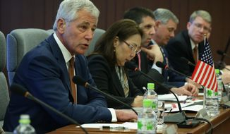 U.S. Secretary of Defense Chuck Hagel, left, speaks during a meeting with Japanese Defense Minister Itsunori Onodera at the Japanese Ministry of Defense headquarters April 6, 2014 in Tokyo, Japan. Secretary Hagel is visiting Japan, China and Mongolia, his fourth trip to Asian nations since taking office. (AP Photo/Alex Wong, POOL)