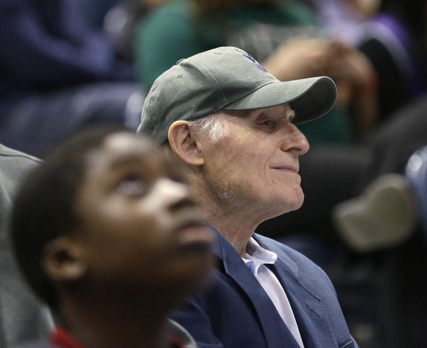 Milwaukee Bucks owner Herb Kohl watches during the first half of an NBA basketball game between the Bucks and the Toronto Raptors on Saturday, April 5, 2014, in Milwaukee. (AP Photo/Jeffrey Phelps)