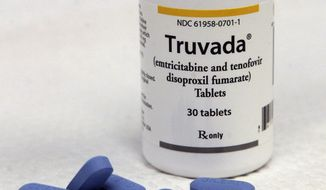This Thursday, May 10, 2012 photo shows Truvada pills and a bottle in San Francisco. Truvada,  a drug hailed as a lifesaver for many people infected by HIV is at the heart of a rancorous debate among gay men, AIDS activists and health professionals over its potential for protecting uninfected men who engage in gay sex without using condoms. (AP Photo/Jeff Chiu)