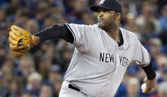 New York Yankees starting pitcher C.C. Sabathia works against the Toronto Blue Jays during the first inning of a baseball game in Toronto on Sunday, April 6, 2014. (AP Photo/The Canadian Press, Nathan Denette)