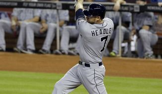 San Diego Padres' Chase Headley follows through on a base hit against the Miami Marlins in the first inning of a baseball game in Miami, Sunday, April 6, 2014. (AP Photo/Alan Diaz)