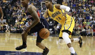 Indiana Pacers forward Paul George (24) tips the basketball away from Atlanta Hawks guard Jeff Teague in the first half of an NBA basketball game in Indianapolis, Sunday, April 6, 2014. (AP Photo/R Brent Smith)