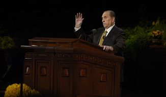 President Thomas S. Monson speaks about the kindness of a smile or a wave during the morning session of the 184th General Conference of the Church of Jesus Christ of Latter Day Saints, Sunday, April 6, 2014 in Salt Lake City. (AP Photo/The Salt Lake Tribune, Scott Sommerdorf)