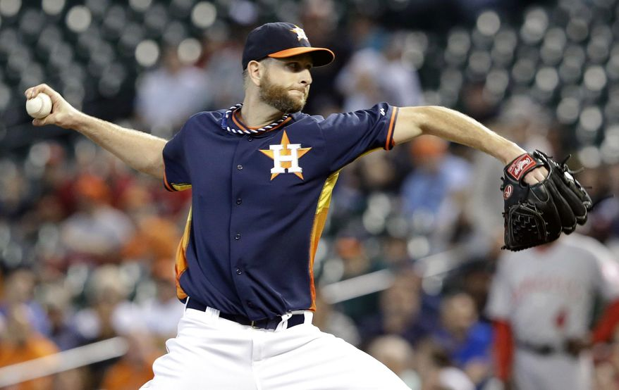 Houston Astros' Scott Feldman delivers a pitch against the Los Angeles Angels in the first inning of a baseball game on Sunday, April 6, 2014, in Houston. (AP Photo/Pat Sullivan)