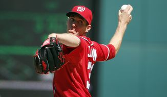 Washington Nationals starting pitcher Taylor Jordan throws during the third inning of a baseball game against the Atlanta Braves at Nationals Park, Sunday, April 6, 2014, in Washington. (AP Photo/Alex Brandon)