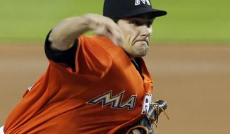 Miami Marlins' Nate Eovaldi pitches against the San Diego Padres in the first inning of a baseball game in Miami, Sunday, April 6, 2014. (AP Photo/Alan Diaz)