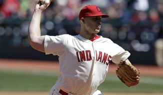 Cleveland Indians starting pitcher Justin Masterson throws in the first inning of a baseball game against the Minnesota Twins, Sunday, April 6, 2014, in Cleveland. (AP Photo/Tony Dejak)