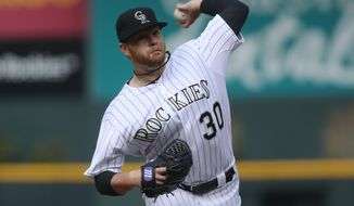 Colorado Rockies starting pitcher Brett Anderson works against the Arizona Diamondbacks in the first inning of an MBL National League baseball game in Denver on Sunday, April 6, 2014. (AP Photo/David Zalubowski)