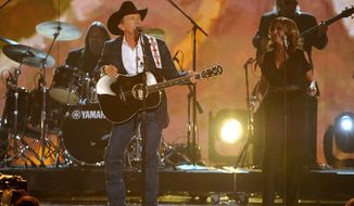 George Strait performs on stage at the 49th annual Academy of Country Music Awards at the MGM Grand Garden Arena on Sunday, April 6, 2014, in Las Vegas. (Photo by Chris Pizzello/Invision/AP)