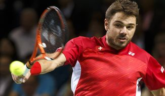 Stanislas Wawrinka, of Switzerland, returns a ball to Mikhail Kukushkin, of Kazakhstan, during the third single match of the  tennis Davis Cup World Group quarterfinal between Switzerland and Kazakhstan,  in Geneva, Switzerland, Sunday, April 6, 2014. (AP Photo/Keystone,Salvatore Di Nolfi)