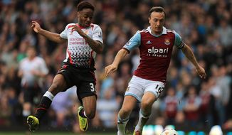 Liverpool's Raheem Sterling (left) and West Ham United's Mark Noble (right) battle for the ball during their English Premier League match at Upton Park, London,  Sunday April 6, 2014.   (AP Photo / Nick Potts,PA)  UNITED KINGDOM OUT  NO SALES  NO ARCHIVE