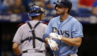 Tampa Bay Rays' Matt Joyce reacts after striking out to end the eighth inning of a baseball game against the Texas Rangers, Sunday, April 6, 2014, in St. Petersburg, Fla. (AP Photo/Mike Carlson)