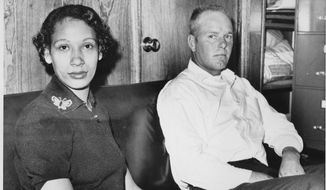 FILE - This Jan. 26, 1965 file photo shows Mildred Loving, a black woman, and her husband, Richard P. Loving, who was white. In 1958, the two Virginia residents went to Washington to get married. After they returned to Central Point, their hometown in rural Caroline County north of Richmond, police raided their home and arrested them. They avoided jail time by agreeing to leave Virginia _ the only home they'd known _ for 25 years.  (AP Photo, File)