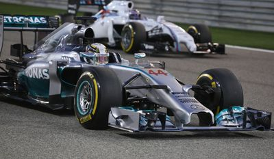 Mercedes AMG Petronas driver Lewis Hamilton of Britain drives prior to the start of the Formula One Grand Prix at the Formula One Bahrain International Circuit in Sakhir, Bahrain, Sunday, April 6, 2014. (AP Photo/Patrick Baz, Pool)