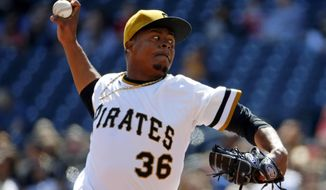 Pittsburgh Pirates starting pitcher Edinson Volquez delivers during the third inning of a baseball game against the St. Louis Cardinals in Pittsburgh, Sunday, April 6, 2014. (AP Photo/Gene J. Puskar)