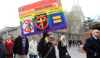 ** FILE ** A group of Utah atheists and former Mormons march around the Salt Lake Temple Square Sunday, April 6, 2014, in Salt Lake City. (AP Photo/Rick Bowmer)