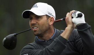 Sergio Garcia tees off on the ninth hole during the final round of the Houston Open golf tournament on Sunday, April 6, 2014, in Humble, Texas. (AP Photo/Patric Schneider)