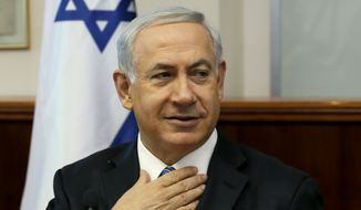 Israeli Prime Minister Benjamin Netanyahu chairs the weekly cabinet meeting in his office in Jerusalem, Sunday, April 6, 2014. (AP Photo/Gali Tibbon, Pool)